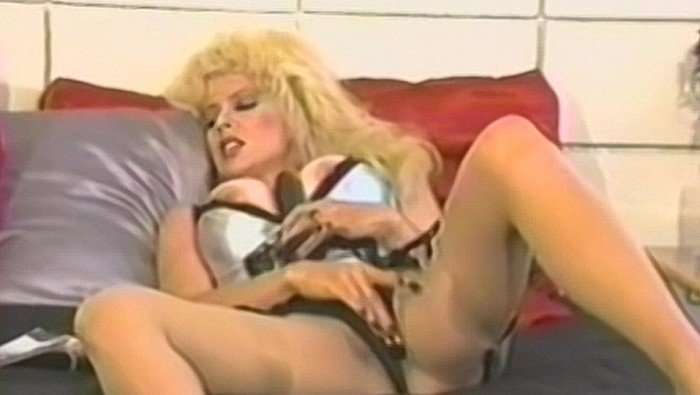 A Big Boobs Blonde Jerks Off With A Big Black Dildo
